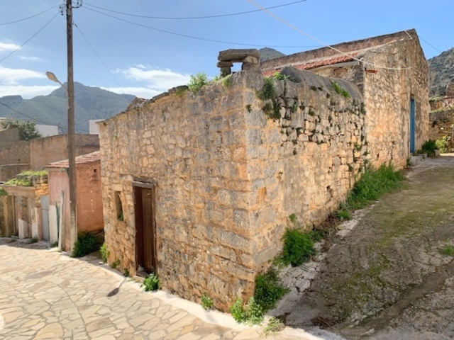 Corner old stone house for sale in Elounda