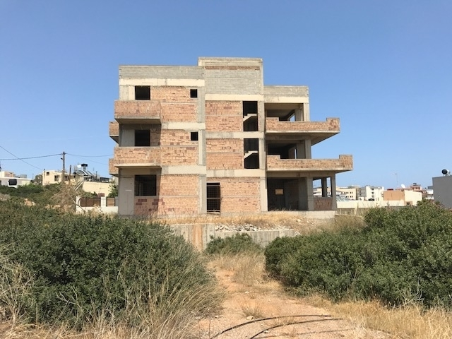 Semi-finished three-store apartment building for sale in Agios Nikolaos